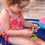 Animal themed nursery rhyme play in the mini pool.