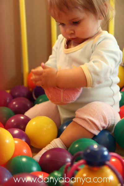 Ball pit play for toddlers (with knitted ball)