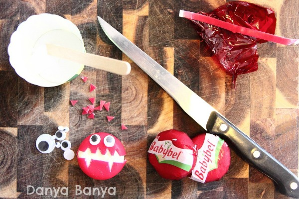 Glue, googly eyes, knife and babybel to make cheese monsters