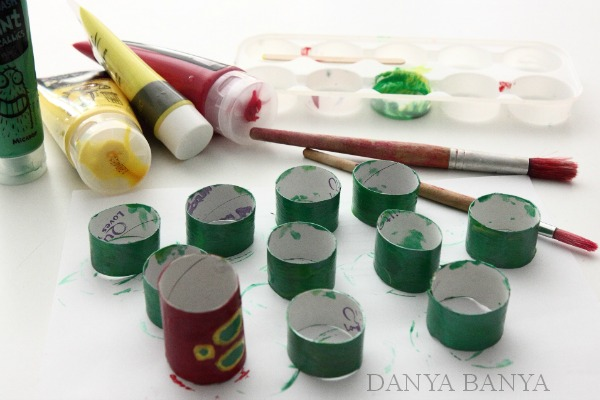 Painting toilet paper rolls for The Very Hungry Caterpillar craft