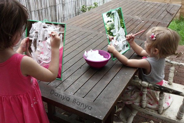 Preschooler and toddler painting on mirrors with shaving cream