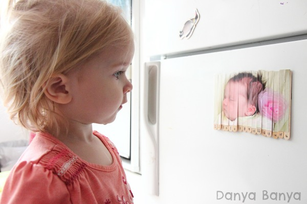 Staring at a puzzle of herself as a baby