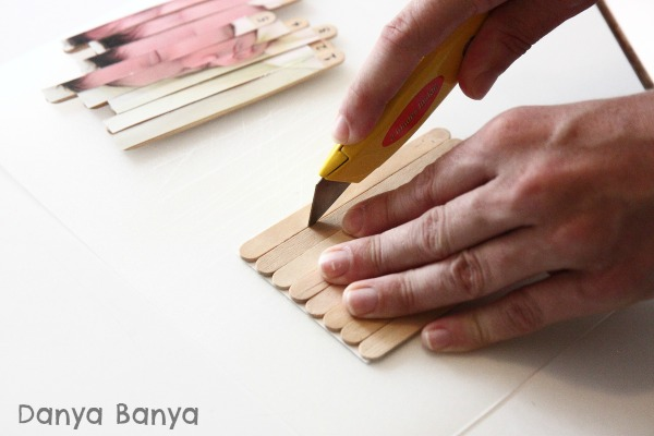 Use a sharp knife to cut the photo puzzle between each craft stick
