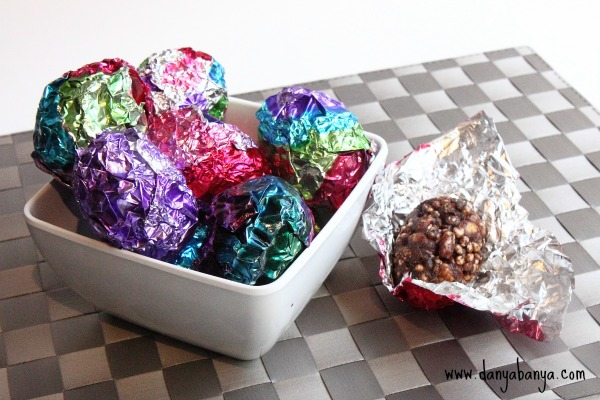 Healthy chocolate crackle Easter eggs in painted foil wrappers