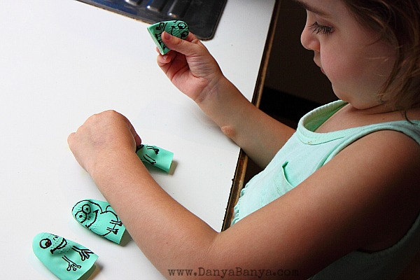 JJ playing with the five speckled frog rubber glove finger puppets
