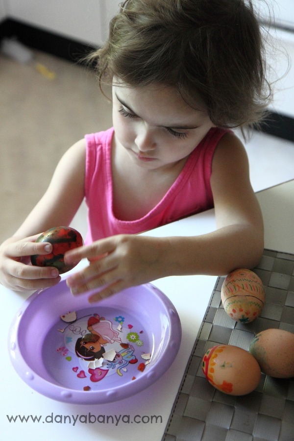 Peeling decorated hard boiled easter eggs is great fine motor skills practise for preschoolers