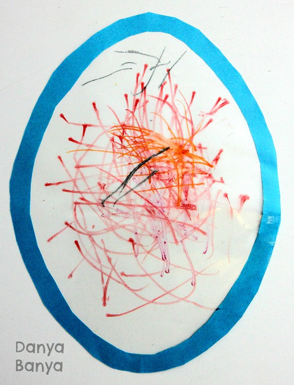 Preschooler Easter egg window art drawing with textas on sticky contact paper