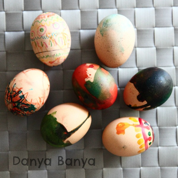 Preschooler hard boiled egg decorating with edible markers and edible paints for Easter