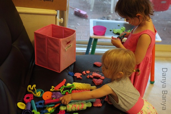 Toddler and Preschooler playing with apple scented play dough