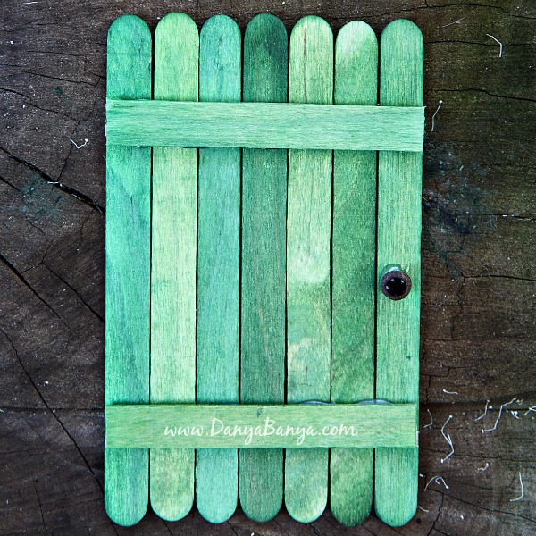 Make a fairy door using green craft sticks