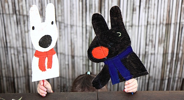 Painted cardboard Gaspard and Lisa puppets with chopstick handles
