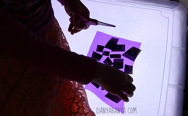 Playing with scissors, cellophane and temporary tattoos on the new light table