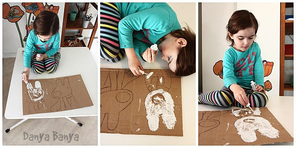 Sitting (and lying down) on the table to paint Gaspard and Lisa - all this creativity is exhausting