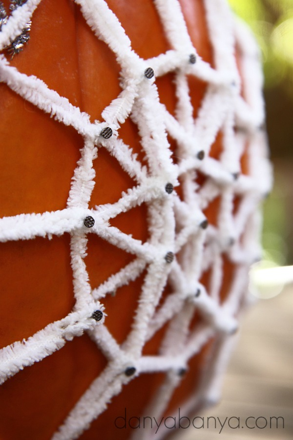 Close up of the yarn pumpkin geoboard