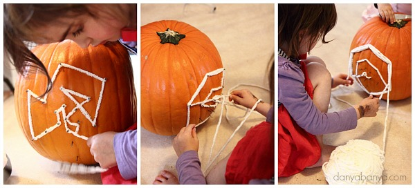 Threading yarn onto the pumpkin geoboard