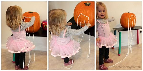 Toddler yarn play with the pumpkin geoboard