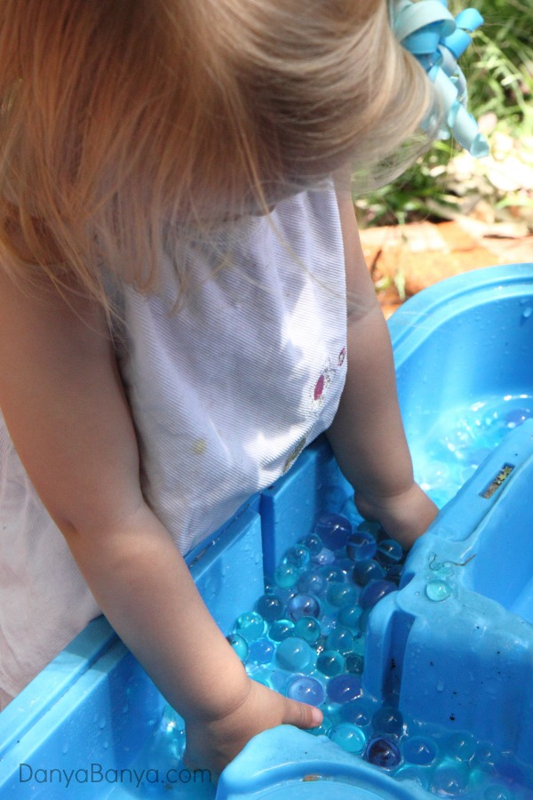 Playing outside with water beads - great sensory play for a hot afternoon