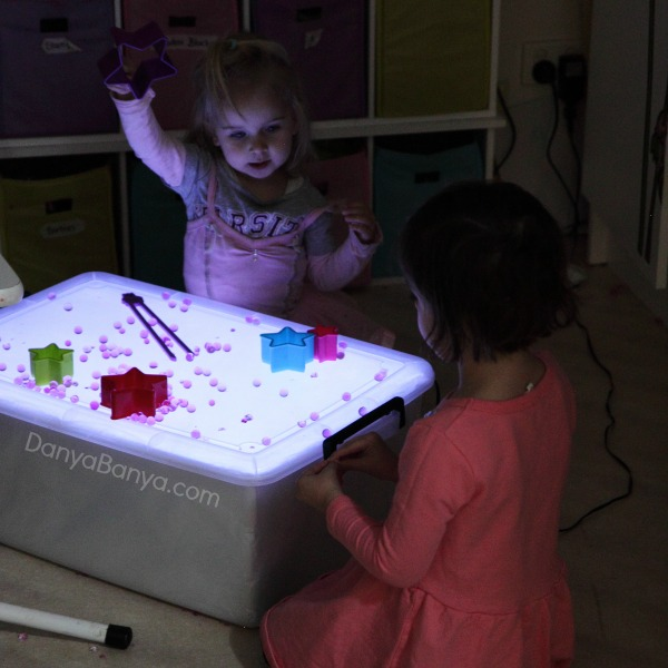 Playing with water beads on the light table