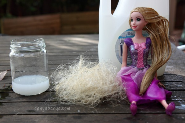 The process of untangling Rapunzel doll hair