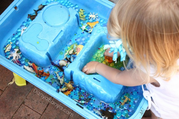 Water beads and sea creatures for an ocean themed small world sensory play