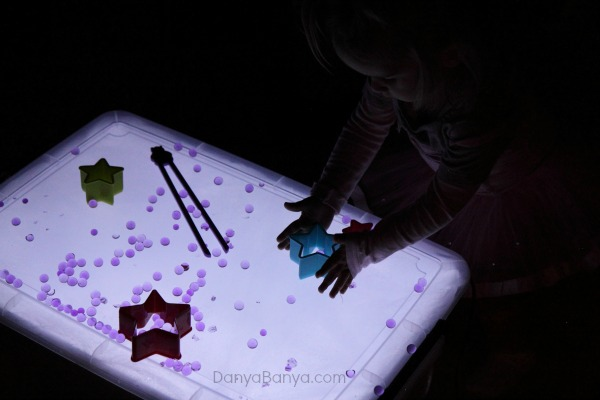 Water beads and star cutters on the light table