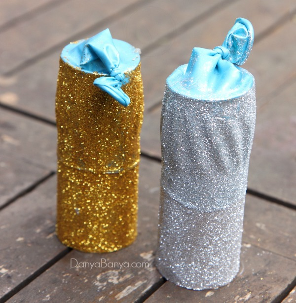 Add craft glue and super fine glitter to make the glitteriest DIY paper poppers ever