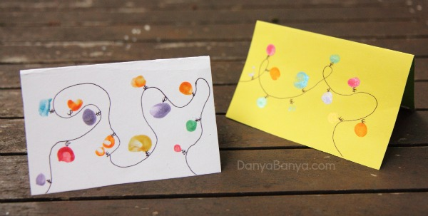 Christmas lights cards made using toddler and preschooler fingerprints