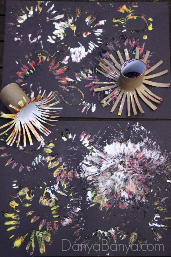 Fireworks paintings using DIY toilet paper roll stampers