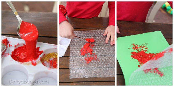 Spooning paint and making prints with bubble wrap
