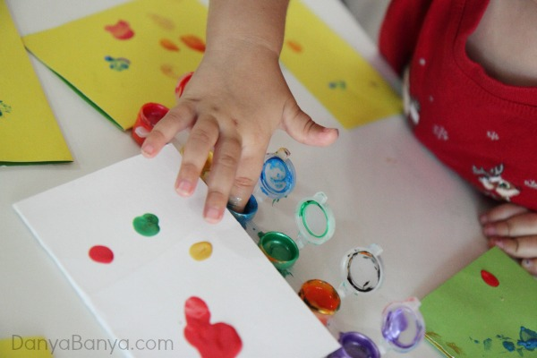 Tiny paint pots are perfect for making fingerprint paintings