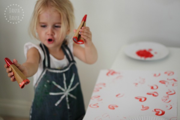 Wielding two heart stampers - great way for toddlers to use both sides of the brain at once