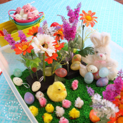 Easter sensory tub with chicks, eggs, flowers and of course, The Easter Bunny