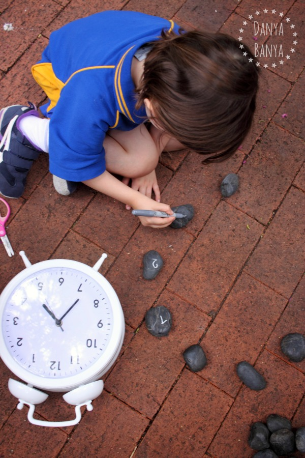 Make a rock clock - playful maths and writing skills activity for kids
