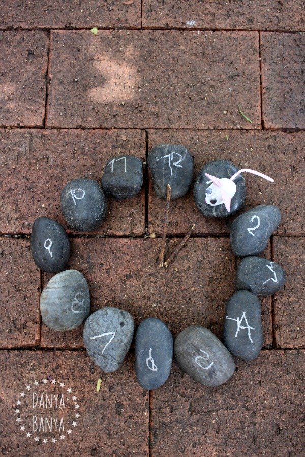 Rock clock and garden stone mouse to go with the nursery rhyme Hickory Dickory Dock