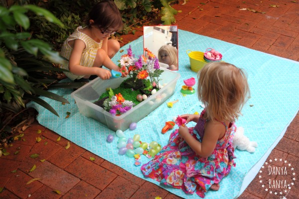 Scooping and pouring - sensory play in the backyard