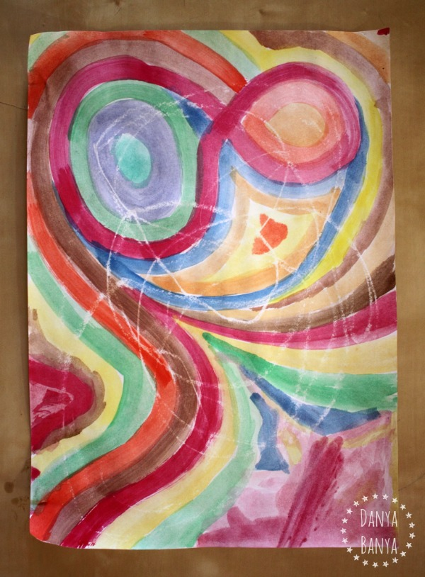 Swirls of watercolour and crayon resist