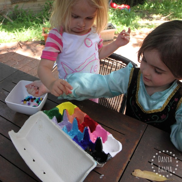 Toddler and preschooler colour sorting with pony beads
