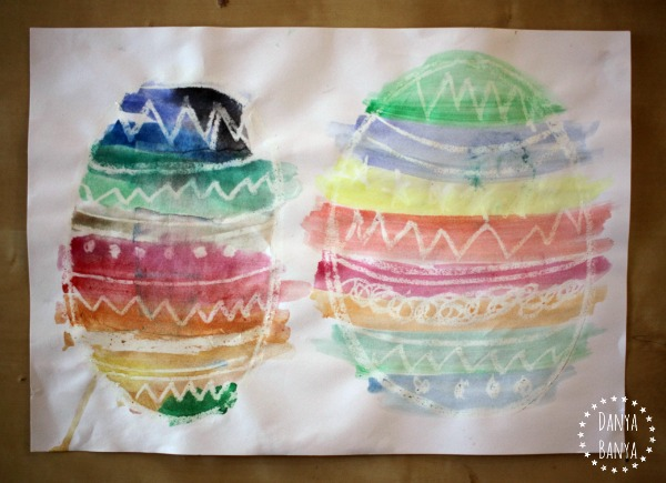 Water colour easter egg paintings using crayon resist technique
