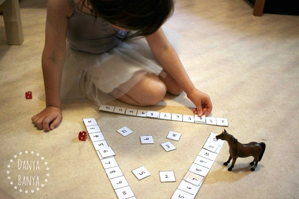 Playful maths fun dice game to help kids learn early maths skills