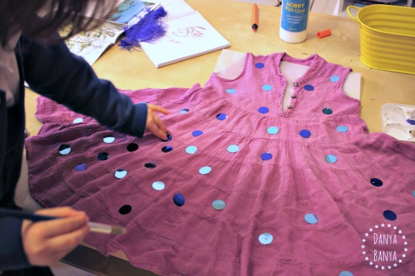 Gluing 100 sequins for the 100th day of school