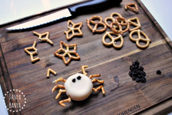 Making a healthy cheese incy wincy spider snack
