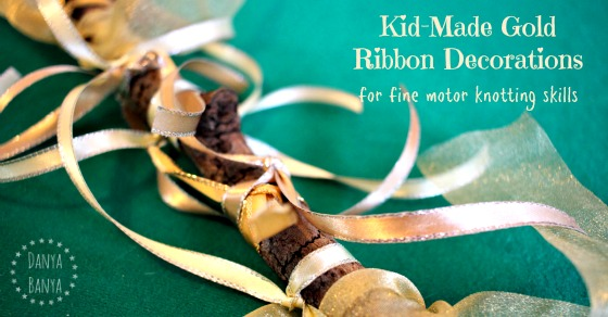 Kid-Made Gold Ribbon Decorations for fine motor knotting skills