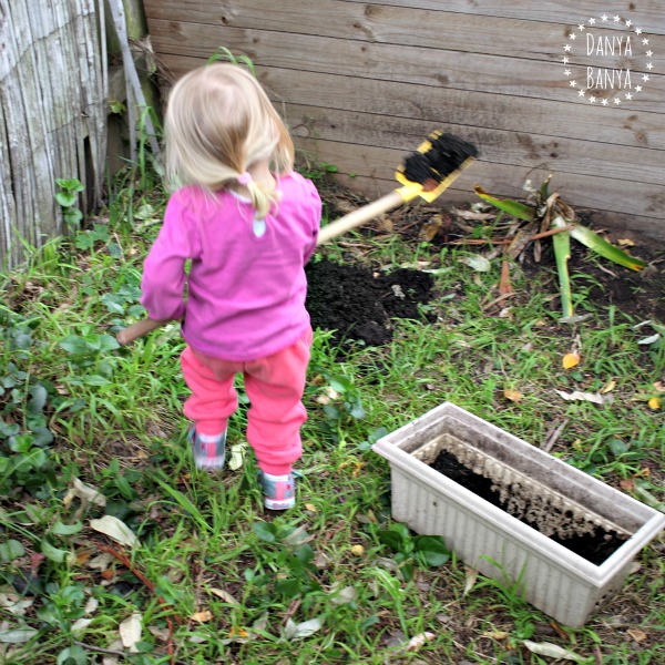 Digging and heavy garden play for toddlers