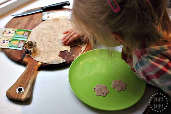 Toddlers can help cut multigrain wrap flower shapes