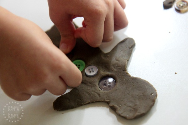 Gingerbread play dough, cookie cutter and buttons for Christmas sensory play