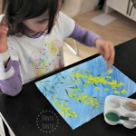 Painting wattle with pom poms