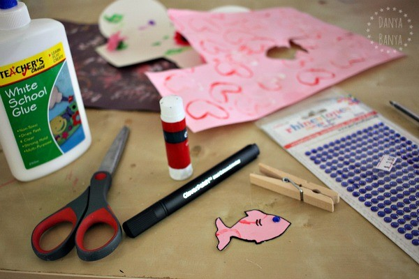 Making nibbling fish pegs using kids artwork
