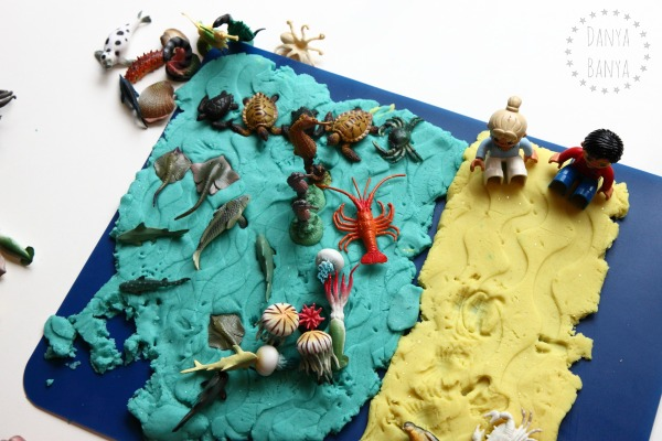 Ocean play dough with sea creatures and Duplo people on the beach