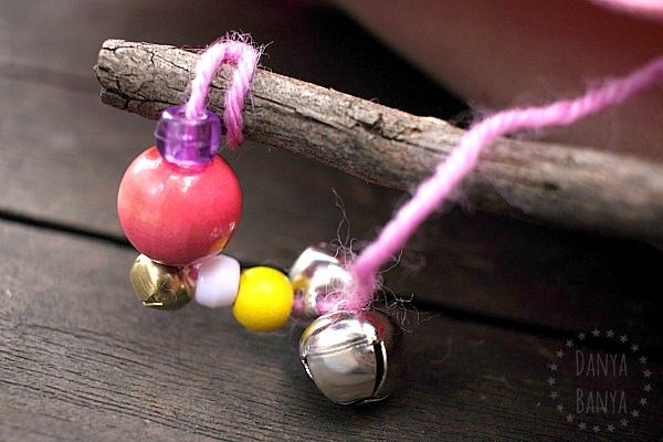 Making a jingle stick with beads, bells and wool (yarn)