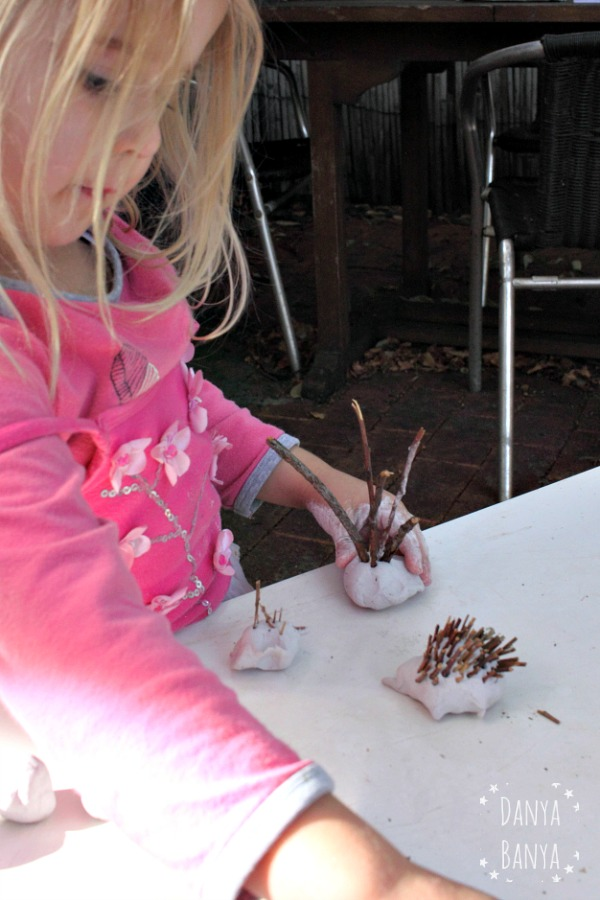 Bee making a clay echidna
